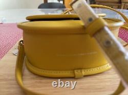 Coach mini top handle saddle bag Leather Turnlock Crossbody NWT yellow 876